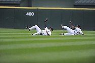 CHICAGO - October 6:  Ken Griffey Jr. of the Chicago White Sox makes a spectacular diving catch on a ball hit by Jason Bartlett, avoiding a sliding Jermaine Dye, in the 4th inning of the game against the Tampa Bay Rays at U.S. Cellular Field in Chicago, Illinois on October 6, 2008.  The Rays defeated the White Sox 6-2 to advance to the ALCS.  (Photo by Ron Vesely)