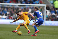 Bailey Wright of Preston NE (l) is challenged by Aron Gunnarsson of Cardiff city (r). Skybet football league championship match, Cardiff city v Preston NE at the Cardiff city stadium in Cardiff, South Wales on Saturday 27th Feb 2016.<br /> pic by  Andrew Orchard, Andrew Orchard sports photography.