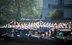 © Licensed to London News Pictures. 07/05/2018. London, UK. People relax on their canalboats in the early morning sunshine at day three of the Canalway Cavalcade festival takes place in Little Venice, West London on Monday, May 7th 2018. Today is expected to be the hottest May bank holiday Monday on record. Photo credit: Ben Cawthra/LNP