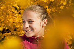 Girl looking away and smiling, close up