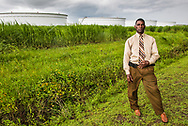 Pastor Harry Joseph near oil storage tanks in St. James, close to the Mount Triumph Baptist Church.  Pastor Joseph helped lead the fight in his community against the Bayou Bridge Pipeline which cuts across Southern Louisiana and terminates in St. James.