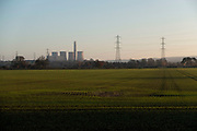 Countryside landscape view towards the decomissioned Rugeley Power Station in Rugeley, Staffordshire, United Kingdom. The Rugeley power stations were a series of two coal-fired power stations located on the River Trent at Rugeley in Staffordshire. The first power station on the site, Rugeley A power station was opened in 1961, but has since been closed and demolished. Rugeley B power station was commissioned in 1970 and closed on 8 June 2016.