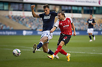 Football - 2020 / 2021 EFL Cup - Round Two - Millwall vs Cheltenham Town<br /> <br /> Alfie May (Cheltenham Town) gets a shot at goal before being given offside  as he beats the outsretched leg of Jake Cooper (Millwall FC) at The Den.<br /> <br /> COLORSPORT/DANIEL BEARHAM