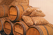 Barrels and bags of corks in the wine cellar - Chateau Haut Bergeron, Sauternes, Bordeaux