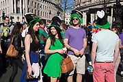 London, UK. Sunday 16th March 2014. Revellers gather in central London for the annual St Patrick's Day celebrations. Saint Patrick's Day or the Feast of Saint Patrick is a cultural and religious holiday celebrated annually on 17 March, the death date of the most commonly-recognised patron saint of Ireland, Saint Patrick. Nowadays the celebration is a fun excuse for some craic and lots of drinking.