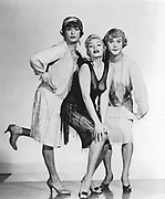Publicity still for the Hollywood film 'Some Like It Hot' (1959): Director and Producer, Billy Wilder.    Marily Monroe with her co-stars Tony Curtis and Jack Lemmon in drag.