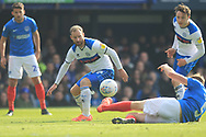 Matty Done is tackled during the EFL Sky Bet League 1 match between Portsmouth and Rochdale at Fratton Park, Portsmouth, England on 13 April 2019.