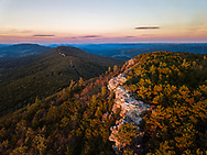Aerial view of the southern ridge line quartzite rock of North Fork Mountain at sunset high above Germany Valley to the west and and the Shenandoah Valley to the East.