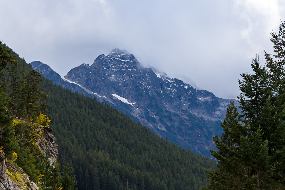 Storm clouds begin to envelop Colonial Peak in North Cascades National Park, Washington State, USA