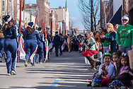 Johnson City, Tennessee, USA - December 7, 2019: A young girl jumps into the air in excitement while watching the annual Christmas parade on Main Street in downtown Johnson City, Tennessee.