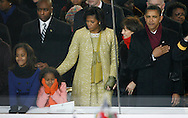 After being sworn in as the 44th President of the United States of America, Barack Obama (L-R), wife Michelle and daughters Malia and Sasha watch the inaugural parade from the reviewing stand in front of the White House in Washington D.C. on January 20, 2009.    (UPI)