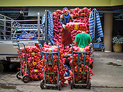 21 OCTOBER 2014 - BANGKOK, THAILAND:  Laborers unload a truck load of onions in the Pak Khlong Talat market on the Chao Phraya River in Bangkok.   PHOTO BY JACK KURTZ