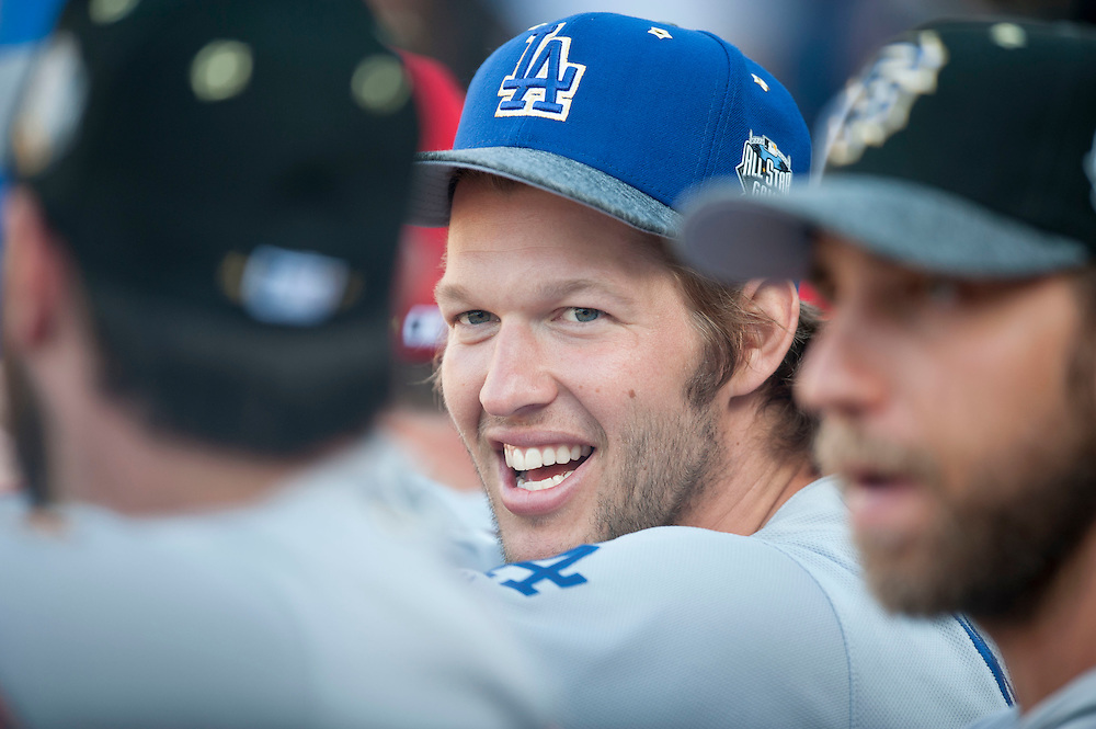 The Dodgers' Clayton Kershaw laughs with teammates during the 2016 MLB All-Star Game at Petco Park in San Diego on Tuesday.<br /> <br /> ///ADDITIONAL INFO:   <br /> <br /> allstar.0713.kjs  ---  Photo by KEVIN SULLIVAN / Orange County Register  -- 7/12/16<br /> <br /> The 2016 MLB All-Star Game at Petco Park in San Diego.