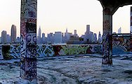 USA, New York city, Queens,  long island city , Manhattan skyline .  Aerosol art and artists in Five points  , art graffiti on the walls of a commercial building, Phun factory ,