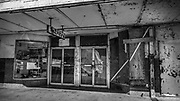 Boarded up store, downtown Laredo, Texas, USA
