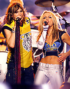 """Pop music star Britney Spears (R) and rock star Steve Tyler (L) from the band """"Aerosmith"""" perform during the halftime show at Super Bowl XXXV in Tampa, Florida. January 28, 2001. Colin Braley/Stock"""