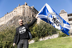 Independence Campaigner Tommy Sheridan waves a Yes flag in front of Edinburgh Castle