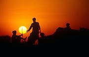 Rajasthani men drink tea at sundown in their camp at the Pushkar Fair, Rajasthan, India