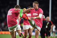Wales players Rhys Priestland (r)and Dan Biggar warm up pre-match. . Rugby World Cup 2015 pool A match, England v Wales at Twickenham Stadium in London, England  on Saturday 26th September 2015.<br /> pic by  Andrew Orchard, Andrew Orchard sports photography.