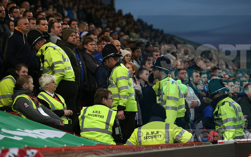 Police and stewards in front of the Leicester fans during the English Premier League match at the Bet 365 Stadium, Stoke on Trent. Picture date: December 17th, 2016. Pic Simon Bellis/Sportimage