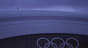A worker walks along the top of the Bolshoy Ice Dome at the Winter Olympics in Sochi, Russia, Thursday, Feb. 6, 2014. (Brian Cassella/Chicago Tribune/MCT)