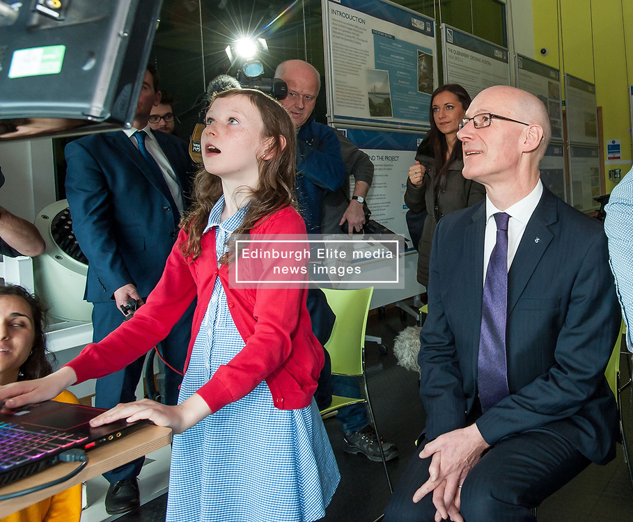 Pictured: Education Secretary John Swinney MSP tries out one of the new interatcive  games with 10 year old Niamh McCormack from Queensferry Primary school.<br /> <br /> © Dave Johnston / EEm