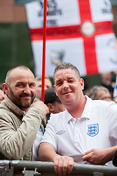 """Rotherham England<br /> 13 September 2014 <br /> EDL supporters outside Main Street Police station where the EDL held a rally as part of the English Defence Leagues """"Justice for the Rotherham 1400"""" March described by an EDL Facebook Page as """"a protest against the Pakistani Muslim grooming gangs"""" on Saturday Afternoon <br /> <br /> <br /> Image © Paul David Drabble <br /> www.pauldaviddrabble.co.uk"""