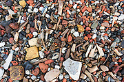 Old animal bones, flint, chalk, coal, and brick pebbles washed up along the Thames, London, UK.