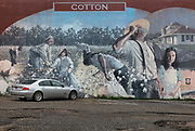 Mural in downtown Dothan carpark, highlighting the history of the area on 5th March 2020 in downtown Dothan, The Peanut Capital of the World, Alabama, United States of America. Most of the murals commemorate something about this section of Alabama, known as the Wiregrass area. Wes Hardin has been commissioned to tell the story of the industrial growth of Dothan, where he makes his home. He has painted the stories of turpentine and logging, of cotton and railroads. He has been commissioned to tell the story of soda fountains and businesses, of Sherman Rose, who trained the Tuskegee Airmen, and of musical legends in the Wiregrass.