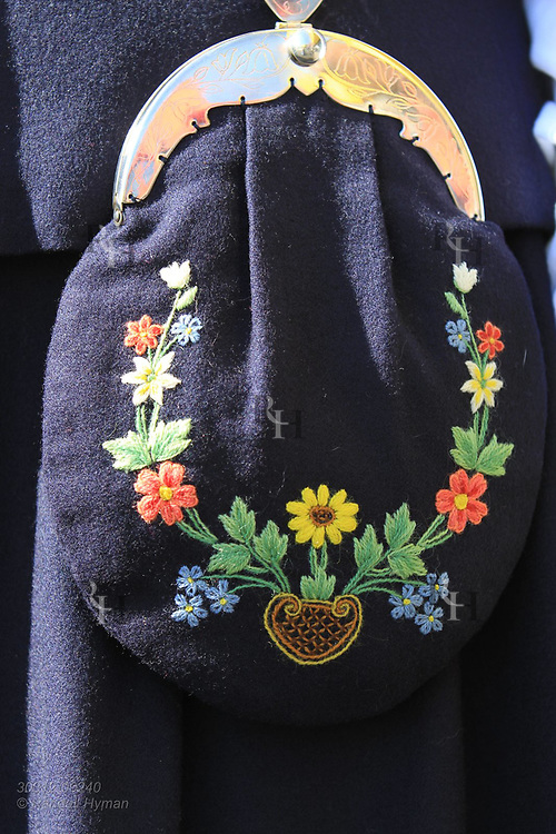 Purse of woman's bunad (national costume) is adorned with colorful embroidery at May 17th Constitution Day celebration of nation's independence in Kirkenes, Norway.