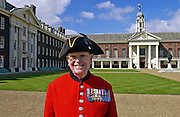 A Chelsea pensioner standing outside the Royal Hospital Chelsea, London