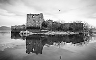 Ruined fortress on Grmozur island, later used as a prison. Lake Skadar (Skadarsko jezero) national park, Montenegro