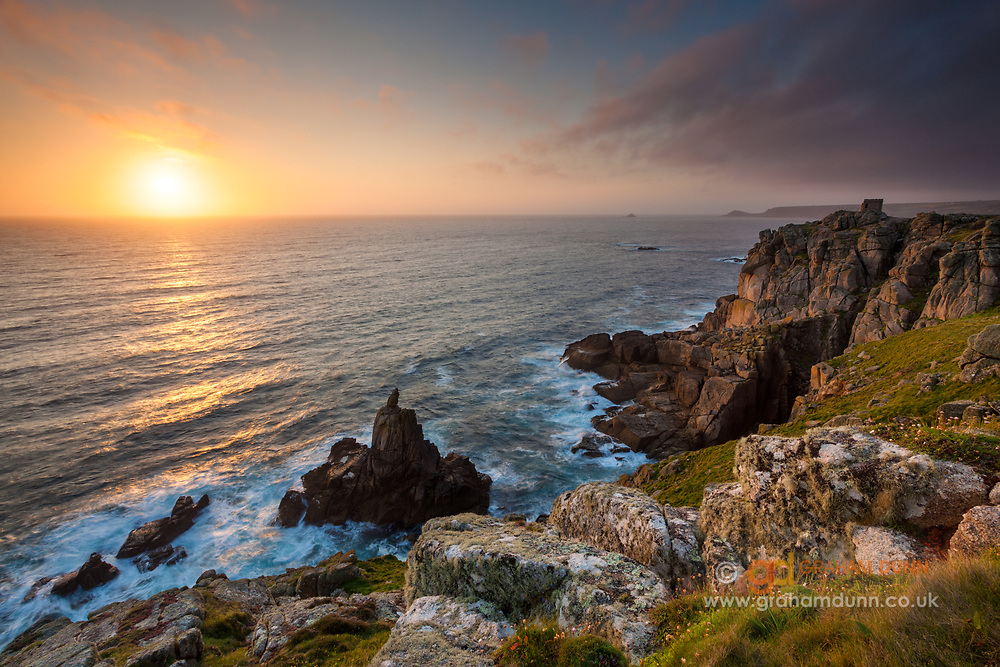 Situated just 1 mile from Land's End, Sennen Cove's Mayon Cliff is the perfect viewpoint for dramatic coastal sunsets. July. Summer in Cornwall, England, UK.