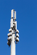 dual band cellular  communications antenna array on pole  with Rado Relay Units RRU and Tower Mount Amplifiers TMAs in Mackay, Queensland, Australia. <br />