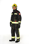 Studio image of a model wearing the uniform of the firefighters based in Barcelona. Shot against a white background the model is wearing full kit and is making eye contact with the camera.