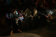 The Central American migrants smoke cigarette at the park near Boulevard Adolfo López Mateos before their departure to Tijuana, Mexico in hopes of seeking asylum in the US. On November 20th, 2018 in Mexicali, Mexico.