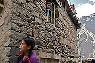 Children hanging out in a village home in Giabong Village, Ropa Valley, Himachal Pradesh, India