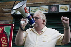 London, UK. 15th July, 2021. Paul Power of Haringey Trades Union Council addresses anti-racist campaigners at an event on Ducketts Common organised by Haringey Stand Up To Racism during which a knee was taken in solidarity with England footballers Marcus Rashford, Jadon Sancho and Bukaya Saka. The three England footballers were subjected to racial abuse following England's Euro 2020 final defeat against Italy.