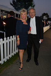 PATTIE BOYD and ROD WESTON at the Chovgan Twilight Polo Gala in association with the PNN Group held at Ham Polo Club, Petersham Close, Richmond, Surrey on 10th September 2014.
