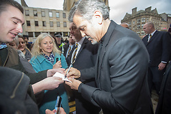 George Clooney leaving the Peoples Postcode Lottery offices, Edinburgh.  Signing Cameron Ross's mums birthday card.