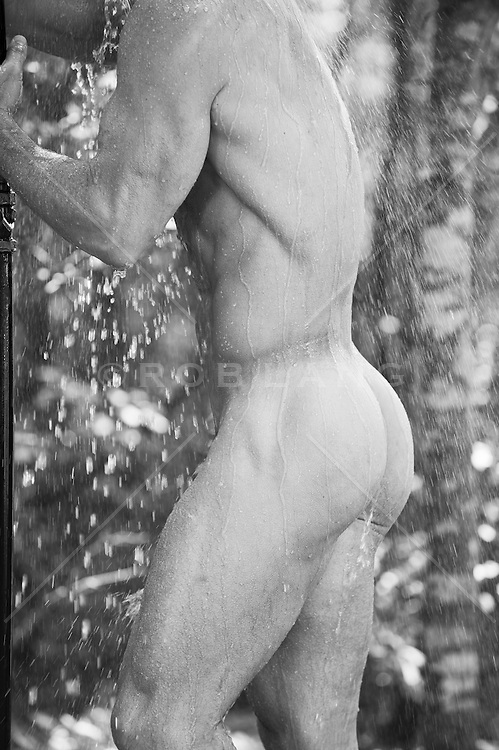 detail of a nude bodybuilder in an outdoor shower