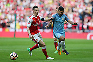 Sergio Aguero of Manchester city ® looks to go past Laurent Koscielny of Arsenal (l) .The Emirates FA Cup semi-final match, Arsenal v Manchester city at Wembley Stadium in London on Sunday 23rd April 2017.<br /> pic by Andrew Orchard,  Andrew Orchard sports photography.