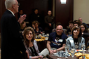 """UConn President Susan Herbst looks on while former head coach Donald """"Dee"""" Rowe speaks during a supporters brunch at the Hyatt Regency in Dallas, Texas before watching her school compete in the NCAA Final Four on April 5, 2014. (Cooper Neill / for The New York Times)"""