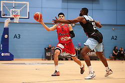 Tevin Falzon of Bristol Flyers attempts a pass under pressure - Photo mandatory by-line: Arron Gent/JMP - 28/04/2019 - BASKETBALL - Surrey Sports Park - Guildford, England - Surrey Scorchers v Bristol Flyers - British Basketball League Championship