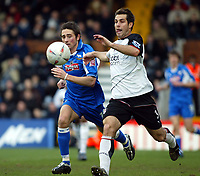 Photo. Chris Ratcliffe, Digitalsport<br /> Fulham v Derby County. FA Cup Fourth Round replay. <br /> 12/02/2005<br /> Fulham's Carlos Bocanegra tussles with Tommy Smith of Derby.