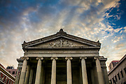 Gallier Hall is an historic building on St. Charles Avenue in New Orleans, Louisiana, United States. The building was originally designed to be the city hall of New Orleans by the noted architect, James Gallier, Sr.. Construction began in 1845, and the building was dedicated on 10 May 1853. Gallier Hall is a three-story marble structure fronted by two rows of fluted Ionic columns in the Neoclassical style. It is one of the most important structures built during the antebellum period of the city.