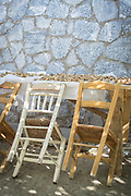 Chairs leaning against table filled with walnuts, Lesbos, Greece