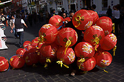 A Chinese workman pulls along a bundle of paper lanterns during preparations in London's Chinatown for the mid-Autumn (also Lantern or Moon) Festival where paper lanterns are to hang. The Mid-Autumn Festival, also known as the Moon Festival or Zhongqiu Festival is a popular harvest festival celebrated by Chinese, Korean, and Vietnamese people, dating back over 3,000 years to moon worship in China's Shang Dynasty. In Malaysia, Singapore, and the Philippines, it is also sometimes referred to as the Lantern Festival or Mooncake Festival. The Mid-Autumn Festival is held on the 15th day of the eighth month in the Chinese calendar, which is in September or early October in the Gregorian calendar. It is a date that parallels the autumnal equinox of the solar calendar, when the moon is at its fullest and roundest.