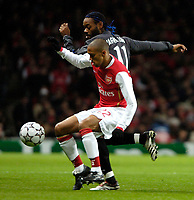 Photo: Ed Godden.<br /> Arsenal v CSKA Moscow. UEFA Champions League, Group G. 01/11/2006. Arsenal's Gael Clichy is approached from behind by Vagner Love.