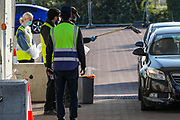 An NHS (National Health Service) worker or care worker is seen dropping off the testing kit at o2 testing Centre for COVID-19 at a drive-through testing centre in a car park at O2 Testing centre in Greenwich, London, Monday, May 4, 2020. <br /> The UK continues in lockdown to help curb the spread of the coronavirus, which has impacted on nations around the globe imposing self-isolation and exercising social distancing when people move from their homes. (Photo/ Vudi Xhymshiti)